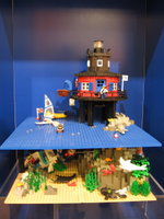 A lighthouse scene inspired by the Seven Foot Knoll lighthouse on display on Pier 5 in Baltimore Harbor.