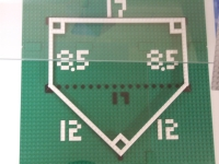 A model showing the measurements of a regulation home plate.